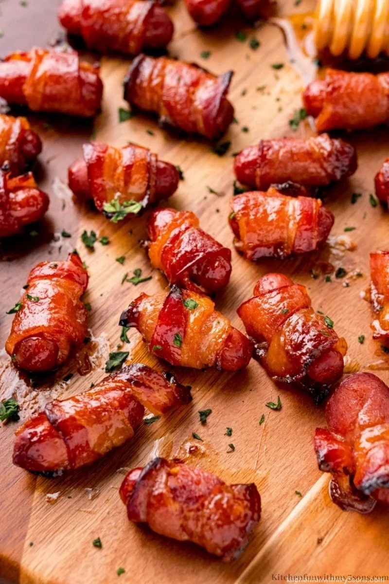 Bacon-Wrapped Smokies topped with parsley.