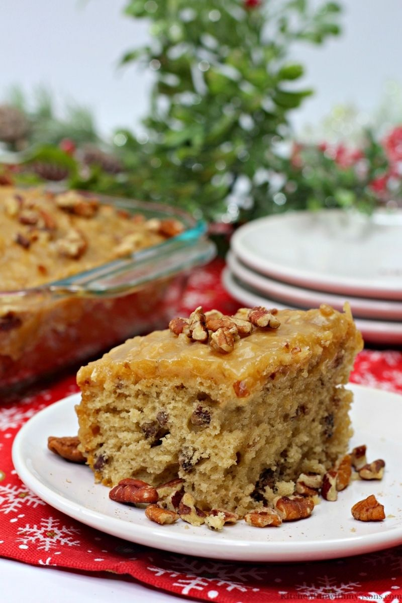 Butter Pecan Sheet Cake with leafed decorations behind it.