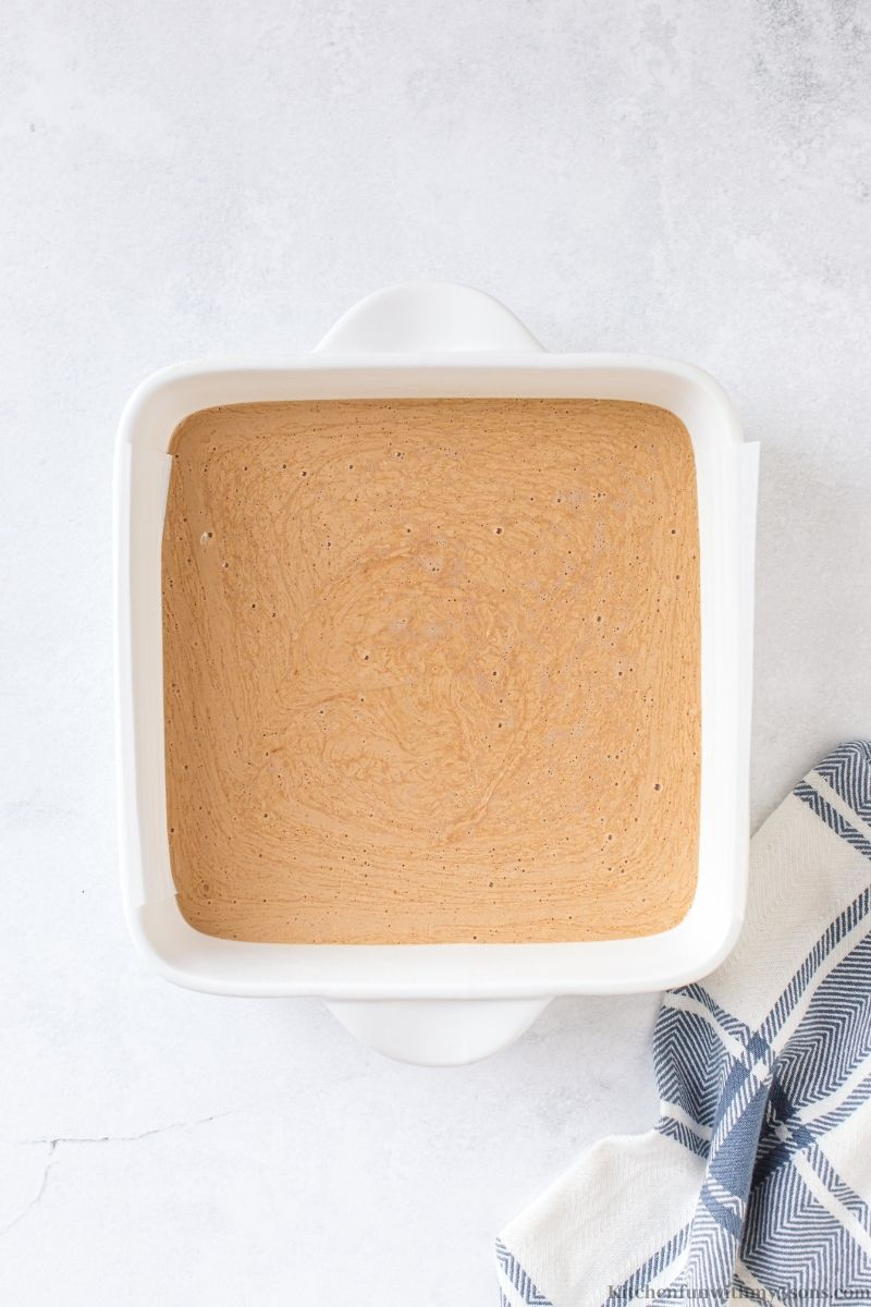 The fudge batter inside the prepared pan.