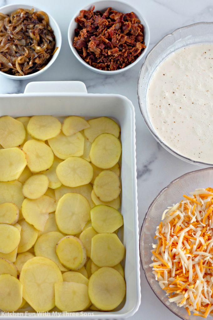 assembling the Cheesy Loaded Scalloped Potatoes