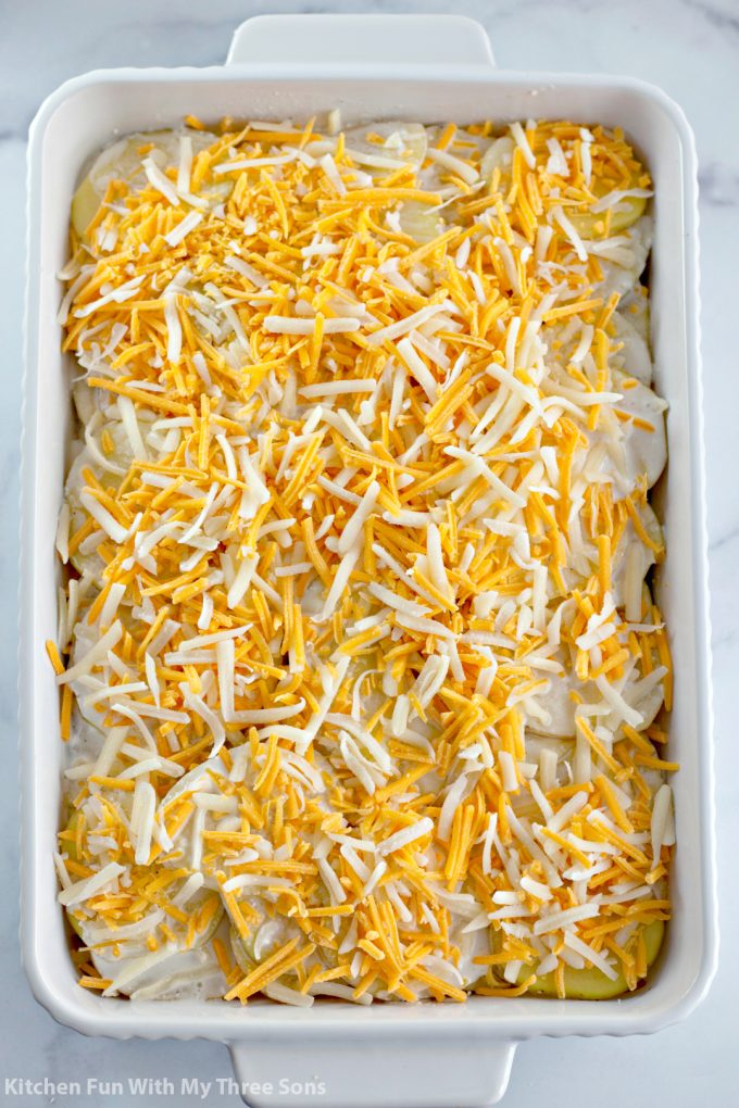 shredded cheese over the potatoes