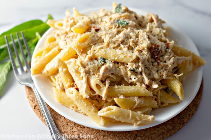 Slow Cooker Olive Garden Chicken Pasta on a white plate