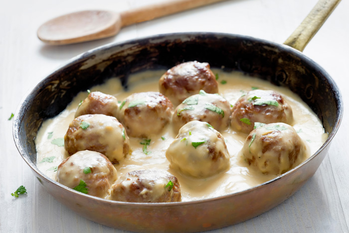 These Swedish Meatballs are my families favorite recipe. They're packed full of flavor and smothered in a creamy beef sauce.