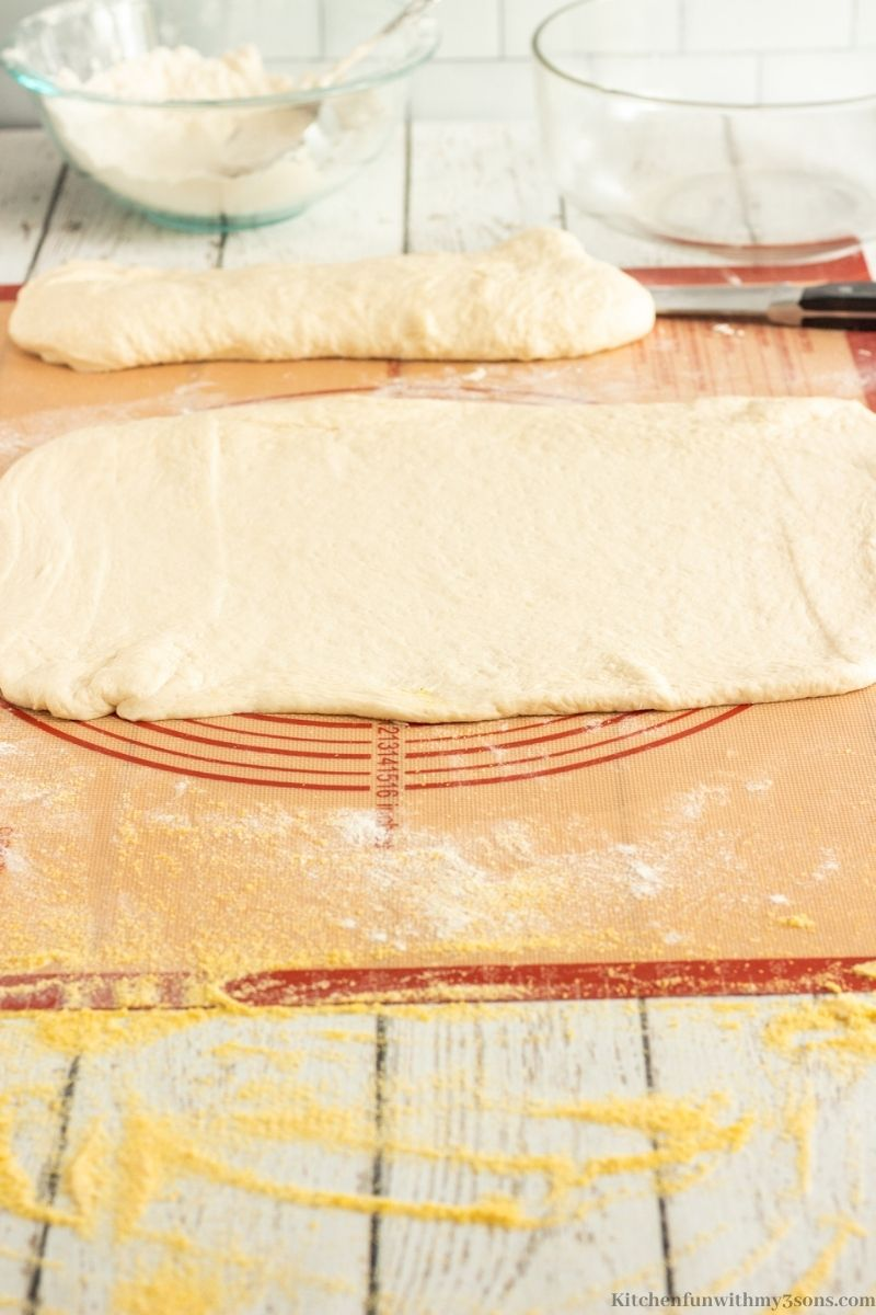 One of the dough portions shaped into a rectangle.