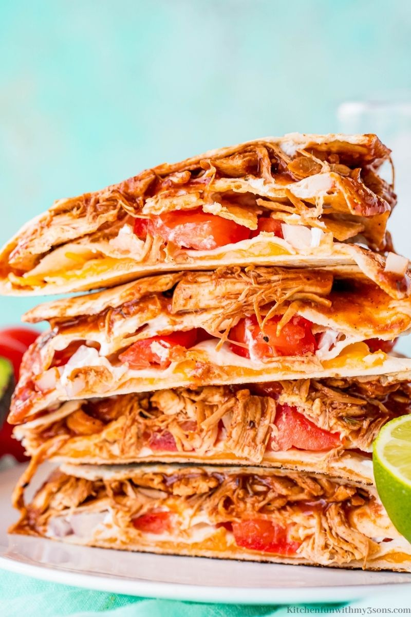 A close up of BBQ chicken quesadilla wraps stacked on each other.