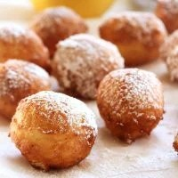 Funnel Cake Bites are a mini version of your favorite fair food. Small bites of fried dough covered in powdered sugar is a warm and delicious dessert.