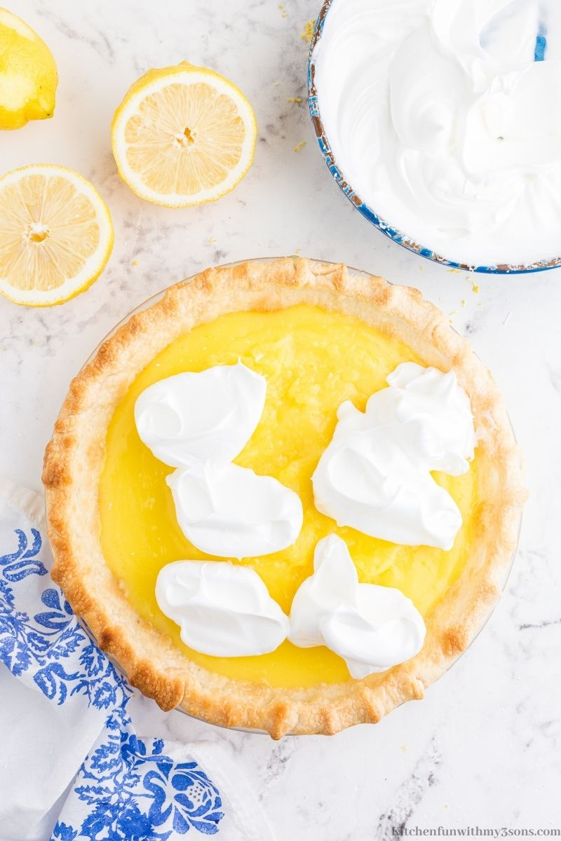 Adding the meringue on top of the lemon filling.