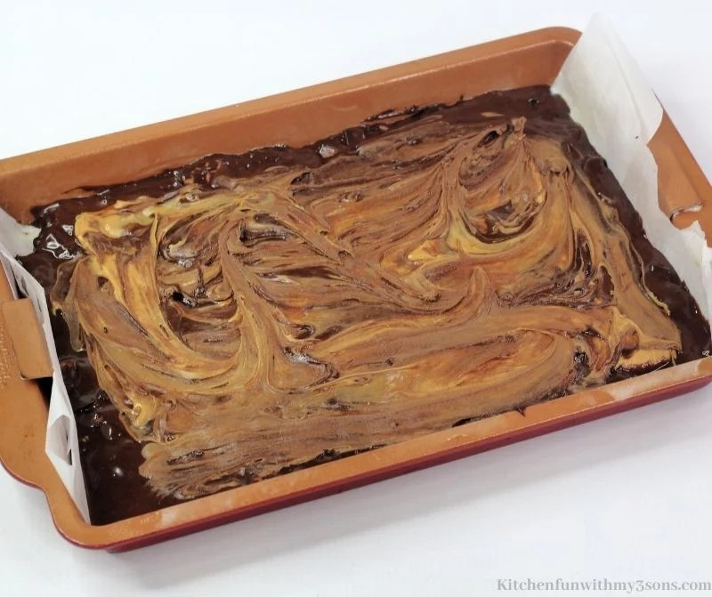 Mixing the peanut butter in with the brownie batter.