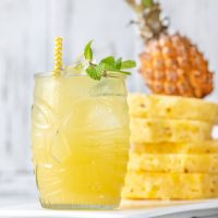 Pineapple Rum Punch is the best new summer cocktail recipe. Just three ingredients and literally seconds to make!