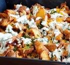 Buffalo kip met aardappelpartjes en kaas uit de oven