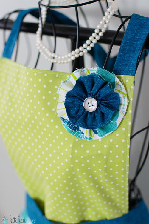 Flower Pin with Silver Button can be worn anywhere on the apron, or wear it with an outfit, or in your hair!