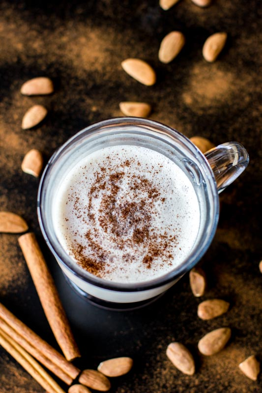 Vegan Warm Almond Milk, Steamed Almond Milk with extra protein: perfect on a chilly night. The addition of almond butter makes this a hearty and filling, which satisfies hunger cravings.
