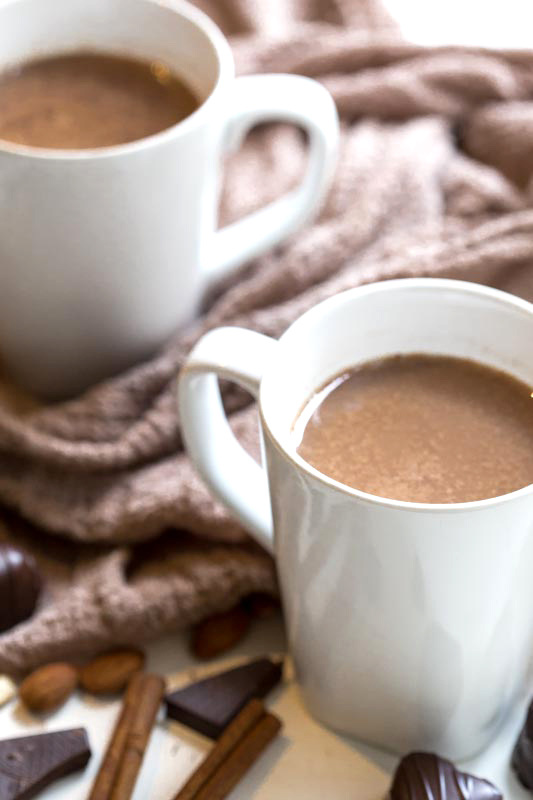 Superfood Hot Chocolate: A Wholesome, nutty, chocolatey & delicious treat loaded with good for you fats, spices & ingredients that will boost mood & health! Vegan + Clean Eating Approved.