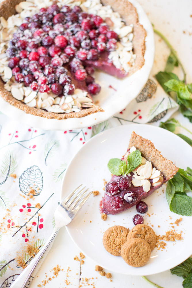 """Cranberry Pie Recipe: Delicious spiced """"gingersnap"""" crumble crust with a silky, sweet cranberry curd filling. Topped with sugared cranberries and almond slices, and made with only the cleanest ingredients."""