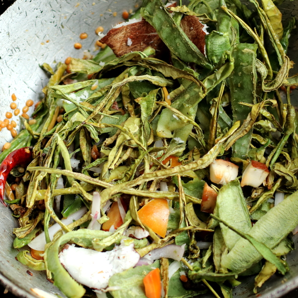 The thuvayal mixture is being fried
