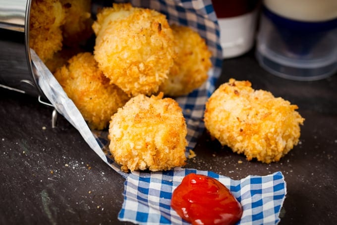 Baked Cheesy Potato Croquettes - An easy bite-sized snack or side dish made from leftover mashed potato.