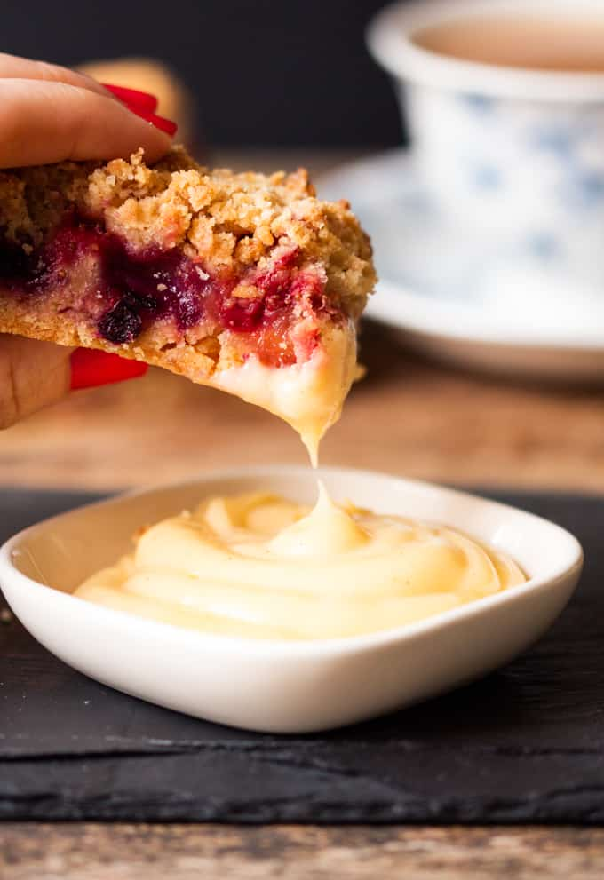 Crunchy biscuit base, juicy berry centre and buttery crumble topping served with a creamy, white chocolate custard dip. One bar is just not enough.