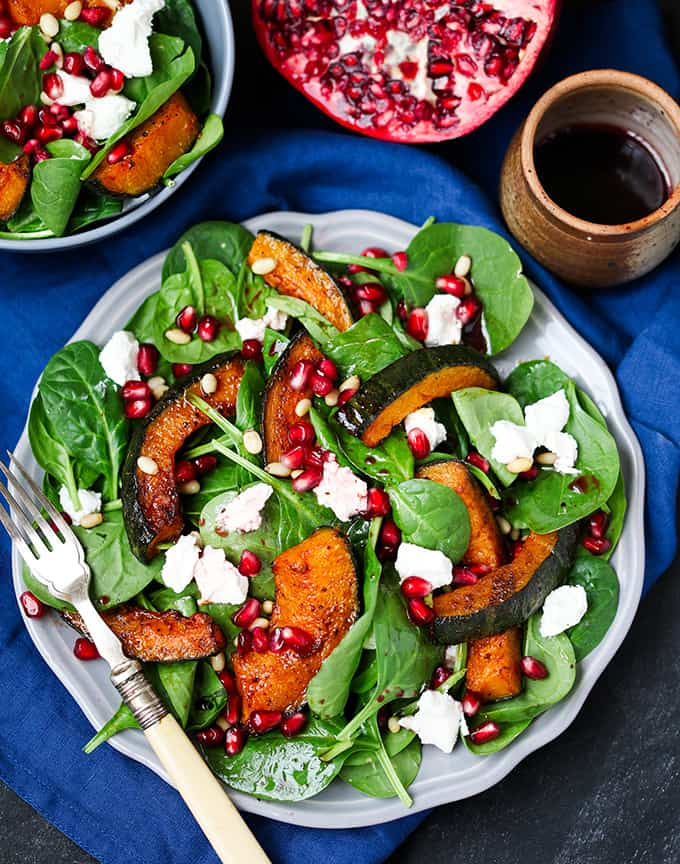 Sweet Roasted Kabocha Squash Salad - with creamy goat's cheese and a tangy pomegranate dressing. A deliciously filling dinner - perfect for Meatless Monday!