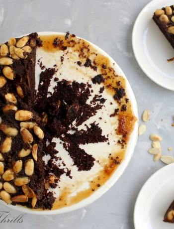 A easy to make chocolate cake folded with chopped pears and topped with caramelized crunchy almonds