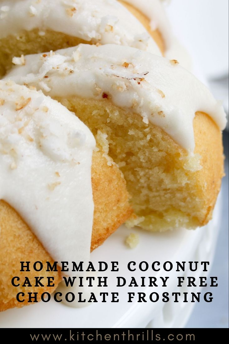 Homemade coconut cake made with fresh coconut and coconut milk topped with a simple dairy free chocolate icing and garnished with toasted coconut. This coconut cake makes the best dessert for Christmas and other holidays. #coconut #cakes