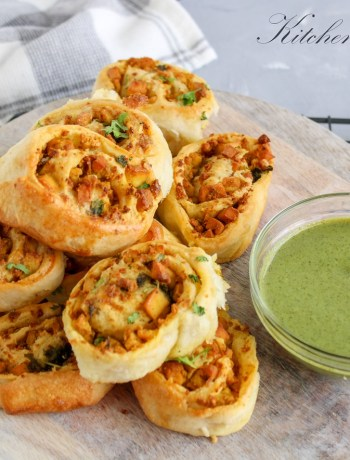 Delicious paneer tikka rolls baked with soft paneer filling and topped with green chutney #bakedpaneer #savouryroll #paneerroll