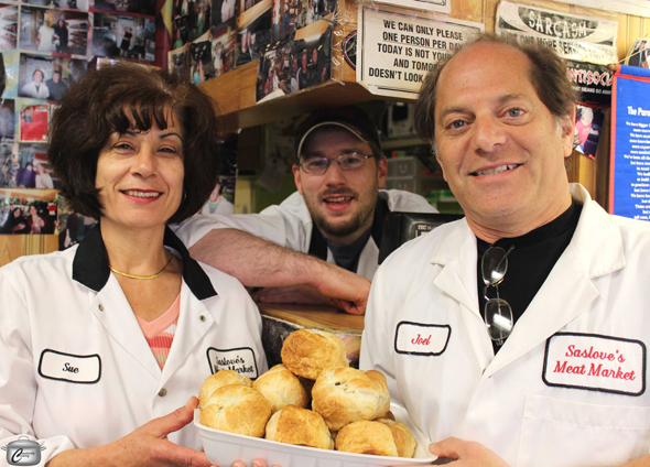 Sue Saikaley, Connor Wells and Joel Diener with knishes. Photo by Paula Roy.
