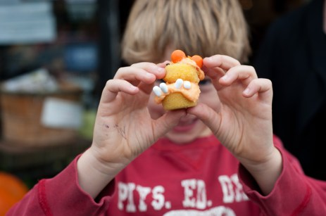 Jamie Settle (10), shows off a pumpkin cupcake. Photo by Kate Settle.