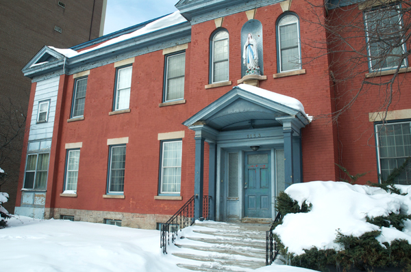 This building is familiar part of the streetscape in Kitchissippi, but do you know what it used to be? And what it is today? Photo by Andrea Tomkins.