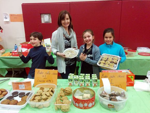Elmdale parent Giselle Incze volunteers at the bake sale with students Matthew, 8, Callia, 8, and Ava, 9.