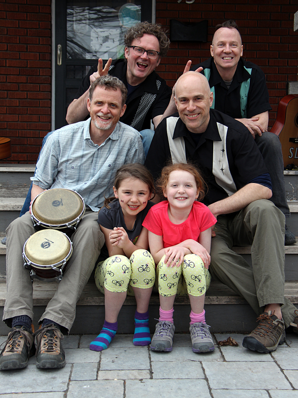 Hey Buster members Sherwood Lumsden, Stephen Skoutajan, Tom Stewart, and Matt Young along with Kate Young and Sophia Skoutajan. Hey Buster is very much a family affair. Young's daughter Kate is featured in the last song on their latest CD, <em>So Long, So Long Goodbye.</em> Skoutajan's daughter Sophia was a dancer in the Mayfair show, and her mother Elizabeth was the choreographer for the dancers. Lumsden's son Thomas did the illustrations on the CD and Stewart 's son, Johnny, does sound at shows. Photo by Andrea Cranfield.