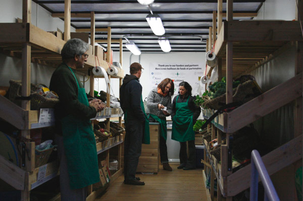 After opening up shop, Market Mobile workers await the first customers. From left to right: volunteers Rakesh Misra and Marc Duclos, project officer Shannon Szkurhan, and volunteer Tracy Facchin. Market Mobile will continue to visit Laroche Park until the end of December. The next visit will be Nov. 4.