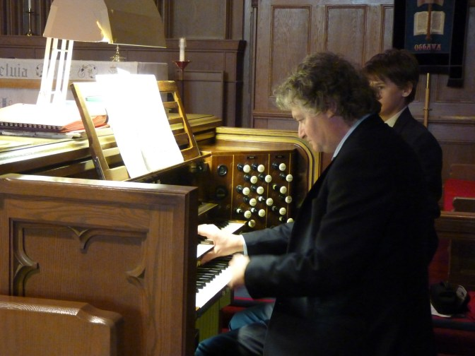 Matthew Larkin playing the Casavant organ at the November 22 recital at St. Matthias Church. Photo by Judith van Berkom