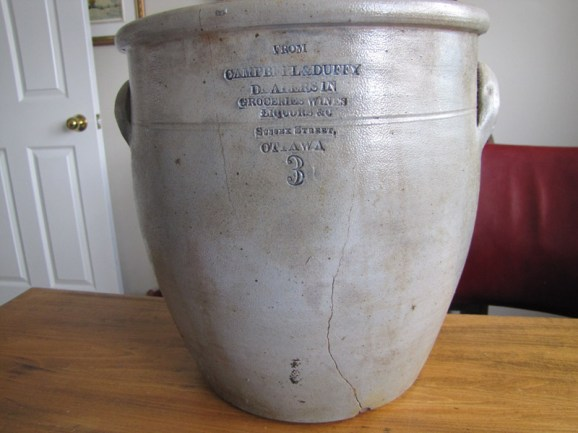 In good condition, because of the rare merchant name, the Duffy & Campbell crock would likely be worth about $500 and perhaps more.