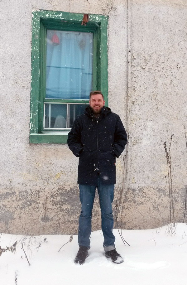 "David Segaert stands next to one of his favourite houses on Armstrong Street. ""The house is falling apart but it makes for by far the most interesting pictures. I've never actually seen anyone going in and out of there,"" he says. Photo by Bradley Turcotte"