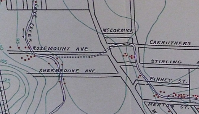 This map from 1911 shows the route of Cave Creek (including the dotted portion where it went underground through caves at Rosemount, and reappearing at Carruthers). The little red dots indicate the location of outhouses located next to the creek.
