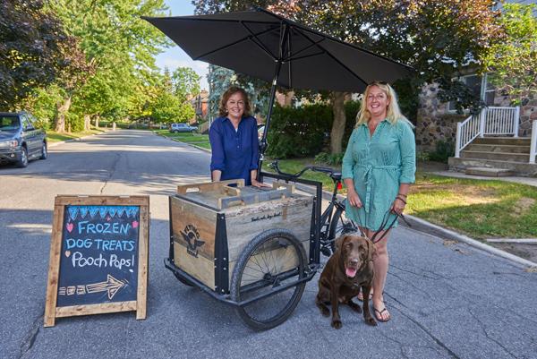 """Karen Gibson and Grazyna Szawlowski with their """"treat trike."""" Photos by Ellen Bond"""