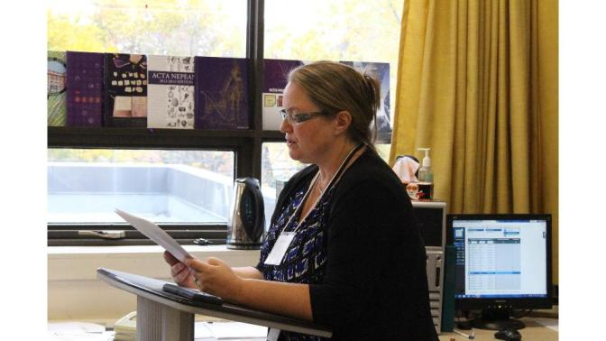 "CBC Radio reporter, Hallie Cotnam, read W.P. KInsella's short story, ""The Thrill of the Grass,"" to Ms. Smid's yearbook class on Oct. 24 for National Library Day."
