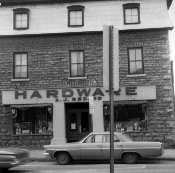 "The ""Magee House"" has a long history in Hintonburg. Here it is in 1965, when it was the location of A.J. Bedard Hardware. Photo courtesy of the City of Ottawa Archives (CA-24326)"
