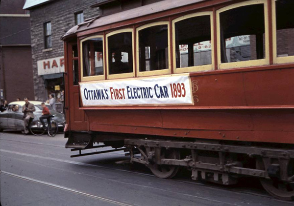 This photo from 1959 shows the streetcar going by Magee House.