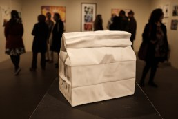 Marble take out bag sculpted by Marcus Jones makes a centre piece at Cube Gallery's Provender art show.