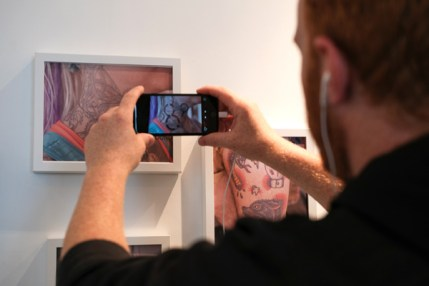 Augmented reality at Railbender Tattoo Studio. Guests used smart devises to reveal animations and videos behind the artwork.