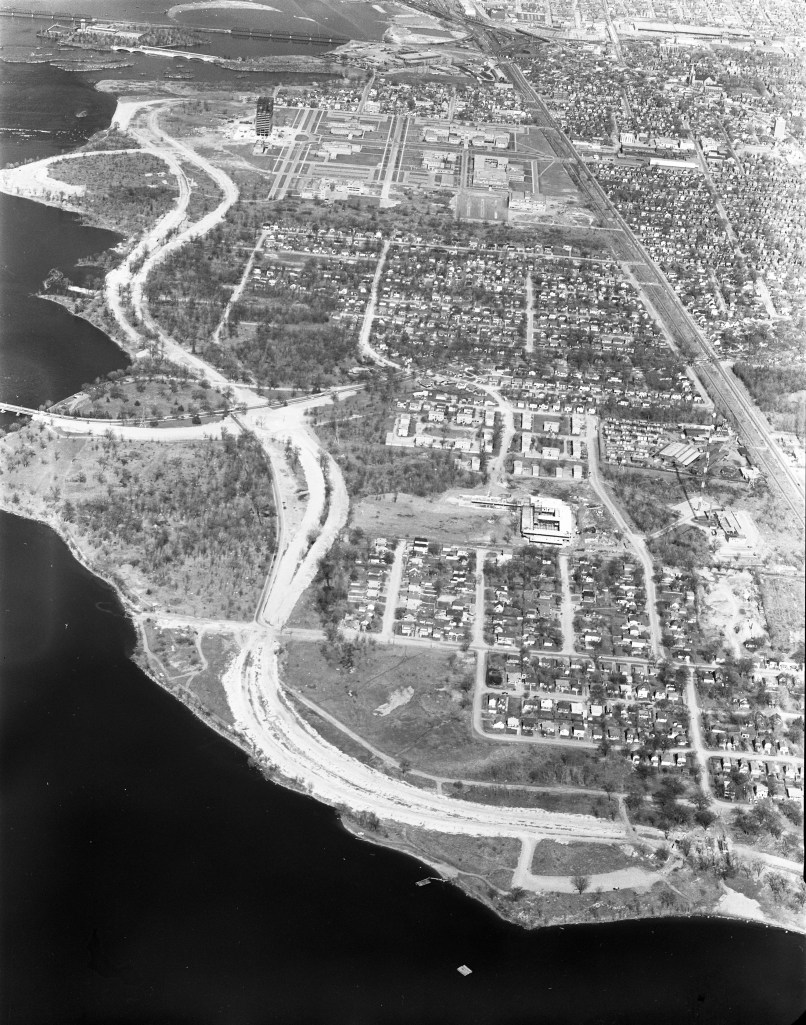 "This aerial photo is from 1963. Westboro Beach is at the bottom and the view looks westward past Tunney's Pasture, etc. ""This is my favourite shot,"" writes Dave Allston, ""with the parkway still under development, and (sadly) all the old roads that had cottages and houses all the way to the water now little ghost towns, Champlain Park especially."" Photo courtesy of the City of Ottawa archives"