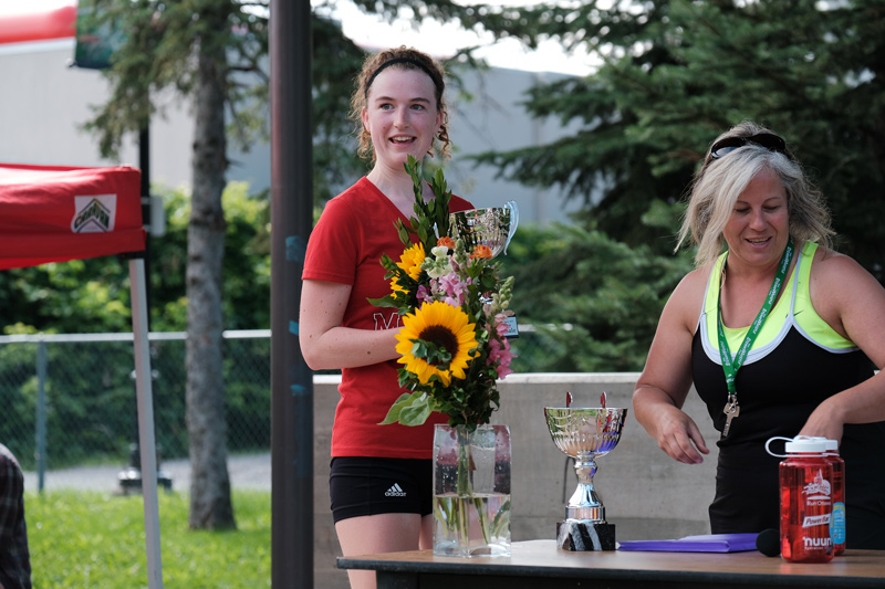 Charlotte Van Walraven receives her award for first place adult female.