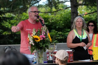 City Councillor and Hintonburg 5K founder, Jeff Leiper, congratulates the runners with race organizer, Lisa Georges.