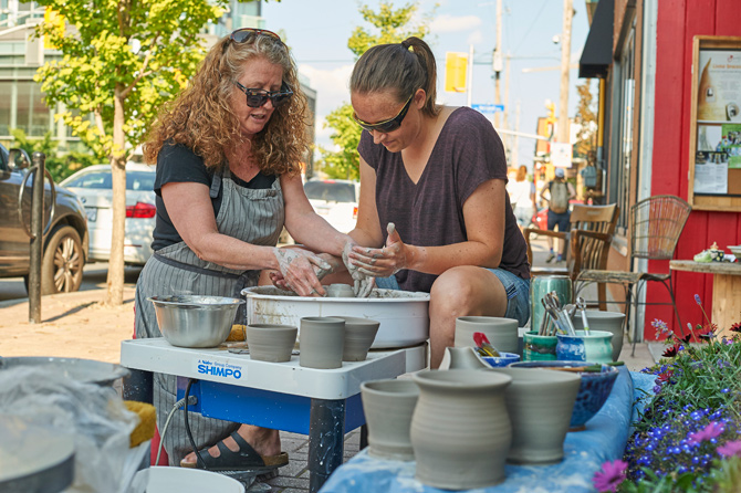 Danika Smith (right) volunteered to try pottery at the Hintonburg Pottery Shop with instructor Ginger McCoy who loves sharing her knowledge and experience with others.