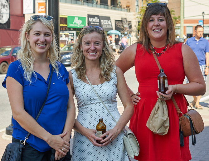 """We work in the area and wanted to check out the event. We're enjoying this great kombucha-infused sangria from the Herb & Spice Shop on Wellington St. W.,"" says Ashley Harris (right). She's pictured here with Alexandra Martin (left), and Kerry Johnston (centre)."