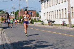 Estefania Martinez rounding the finial corner to finish 1st in her category: 00:20:40.2