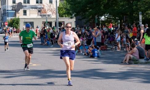 Amy Bienkowski nears the finish followed by Christophe Rene, close behind