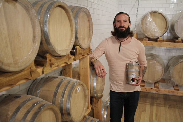 Wine Bottega manager Jonathan Percival imports grape juices from around the world and then ferments them on-site for his customers, producing a unique and consistent taste. Photo by Jacob Hoytema