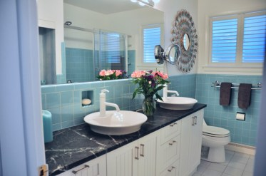 Check out the original tiles in the main bath! Photo by Andrea Tomkins